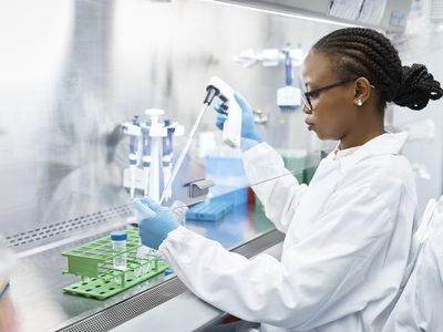Scientist analyzing medical sample in laboratory