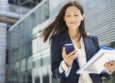 Worker using cell phone in office
