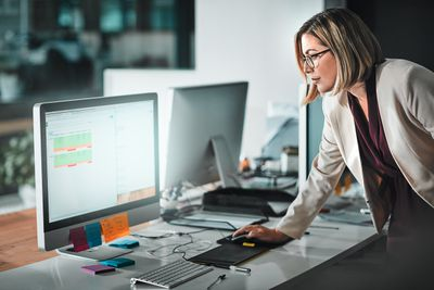 Woman working on schedule on a computer
