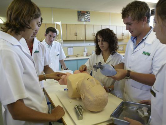 Medical students practice CPR on a dummy