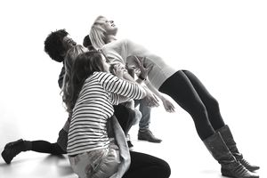 Woman being supported by 4 people
