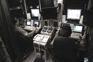 Engineer equipment electrical systems technicians (MOS 1142) working in a command center on base