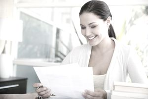 Woman looking over letter