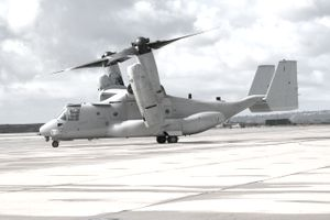 A military MV-22 Osprey preparing to takeoff on a cloudy day