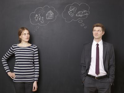 man and woman thinking of their financial dreams