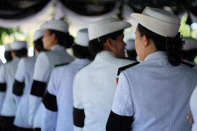 Rear View Of Female Navy Officers During Military Parade