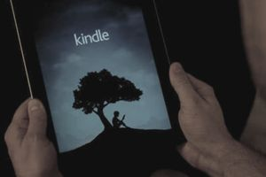 Man holding tablet and logging into Kindle ebooks