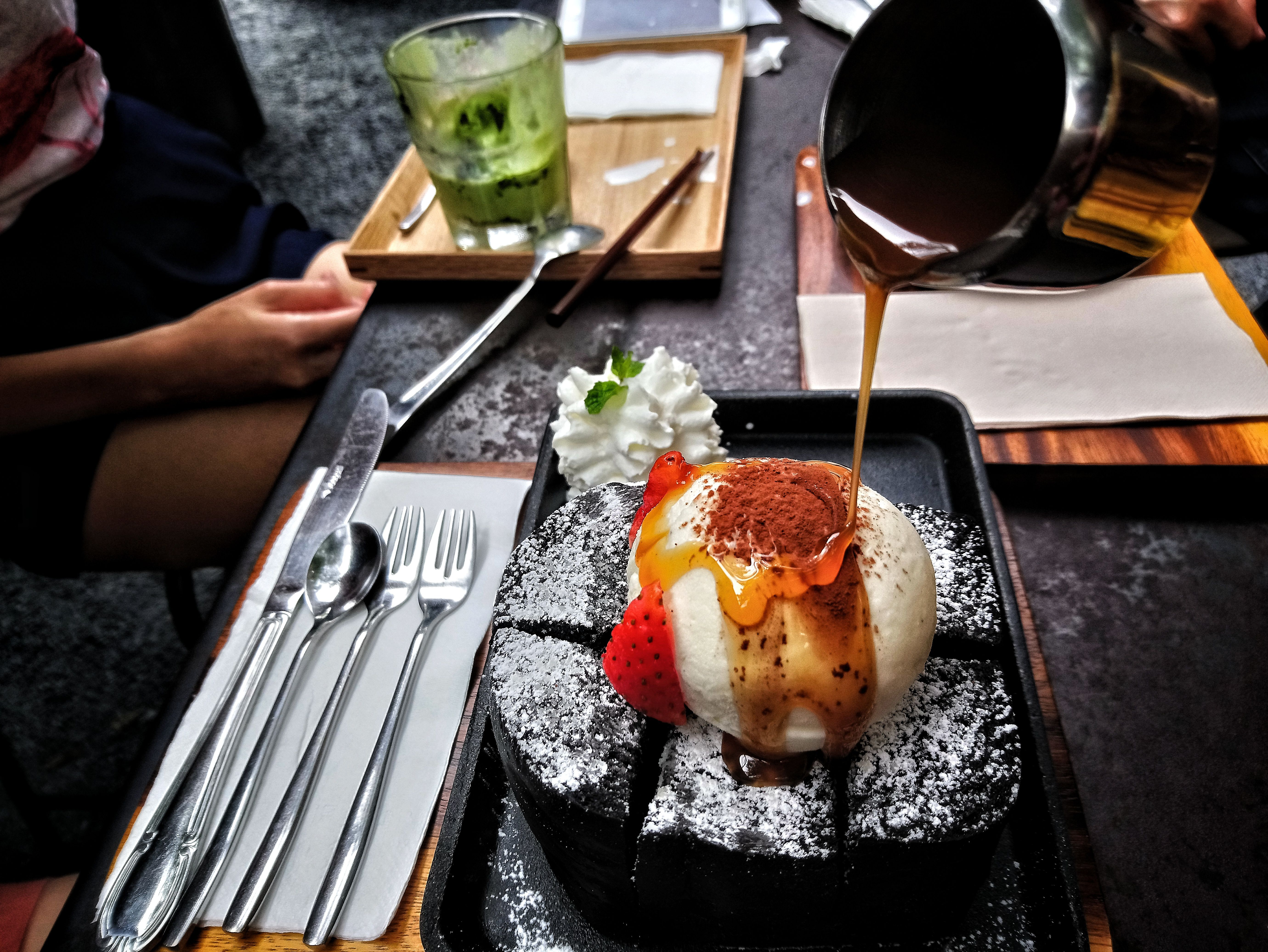 Charcoal honey toast with vanilla icecream and strawberry on top