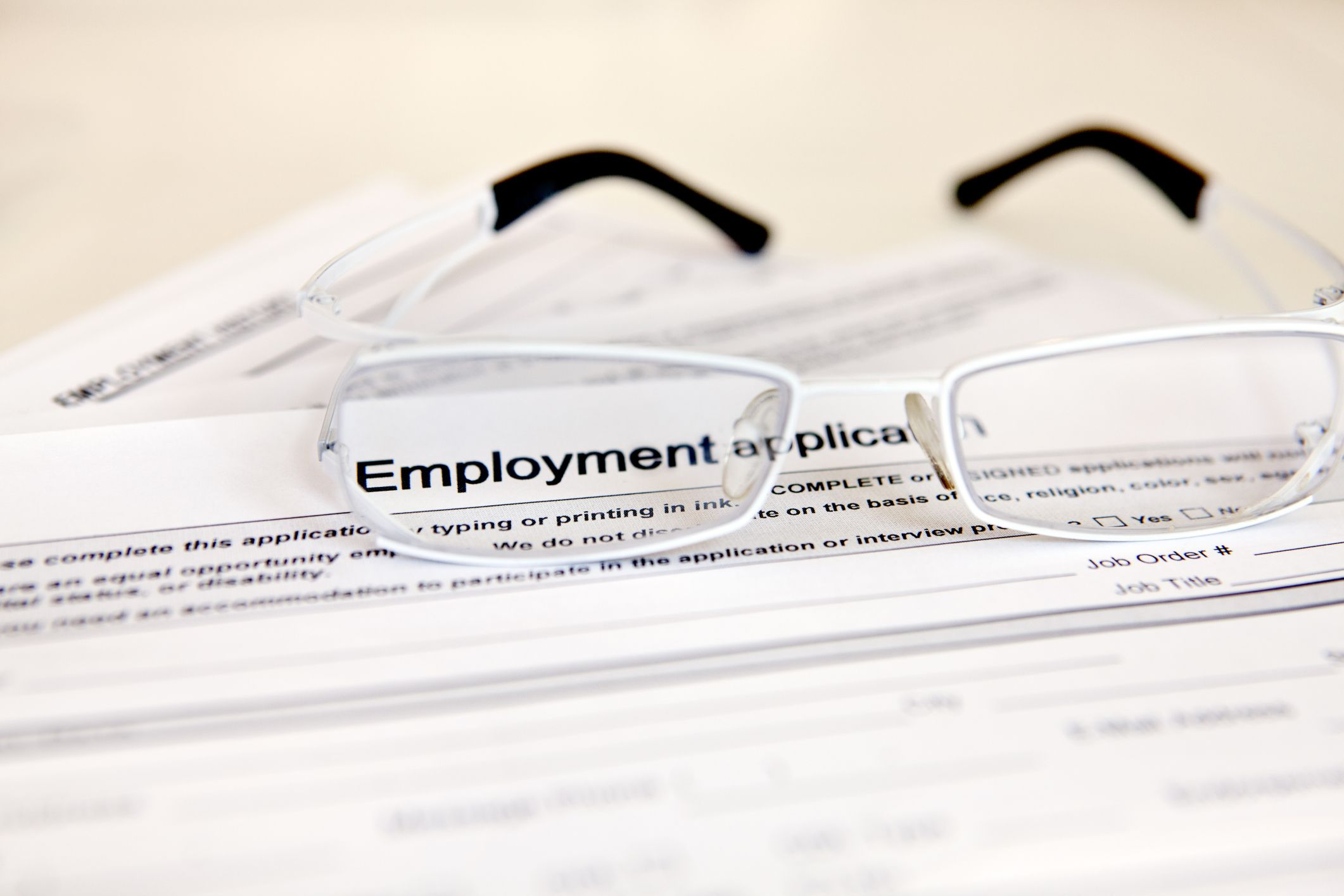 job application with glasses
