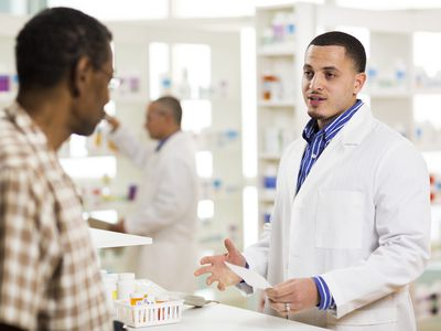 Pharmacist giving medication to a patient - tretinoin vs isotretinoin