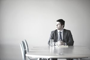 man in empty board room waiting for job interview