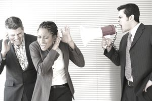 Man with a bullhorn hollering at coworkers represents one of the nine worst ways to manage people.