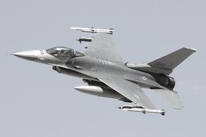 An F-16C Fighting Falcon flies by during a U.S. Air Force firepower demonstration at the Nevada Test and Training Range