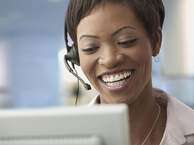 woman wearing headset at computer