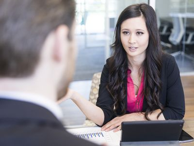 Employee discussing her development plan with a manager