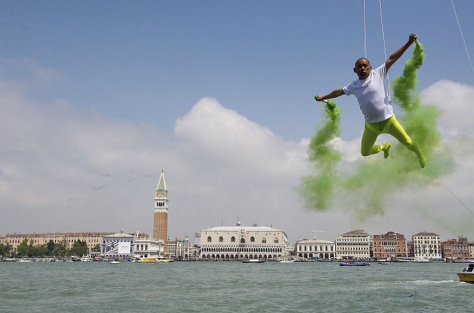 Chinese artist Li Wei performs in front of Saint's Mark at the 55th Venice Biennale on May 28, 2013 in Venice, Italy.