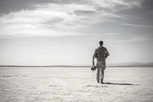 Army solider walking in the desert