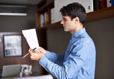 Business person reading letter