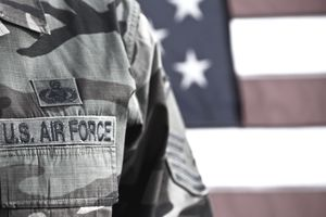 US Air Force uniform in front of american flag