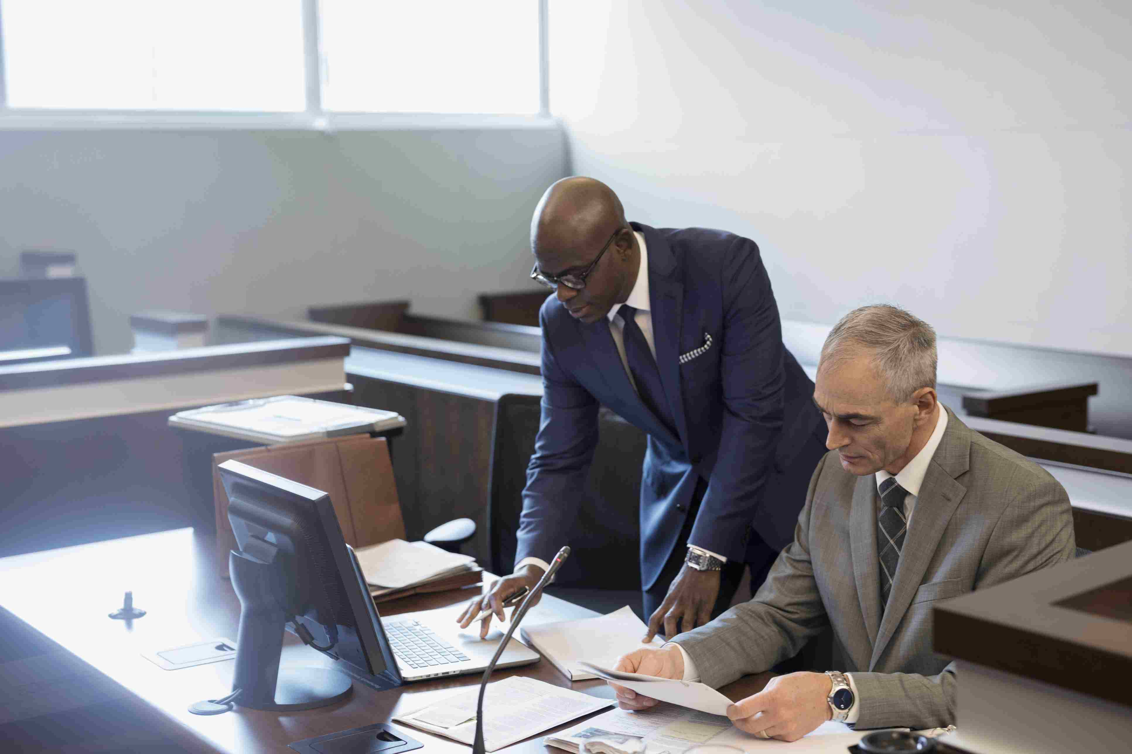 Male prosecutor attorneys working in courtroom