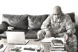 soldier studying on sofa