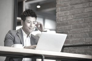 businessman with laptop in cafe