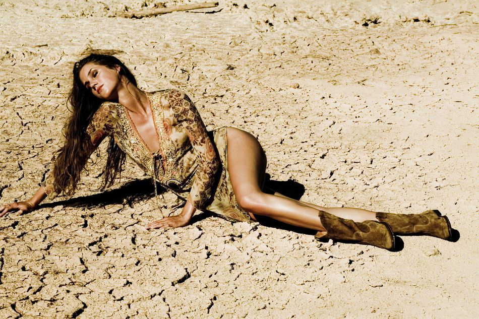 Girl lying in dry desert