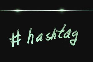 A neon sign that reads #hashtag.