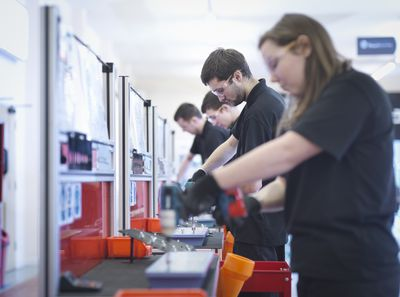 Apprentices working on training production line