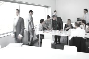 a group of business people conversing in a training area
