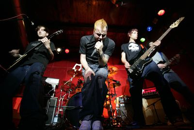a rock band playing live