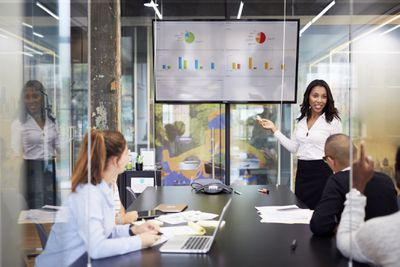 A chief people officer talks to company employees