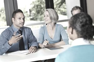 Business team of professionals conducting a job interview to hire an employee for a critical, value-added role.