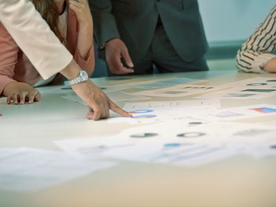 Woman pointing at document on table in meeting