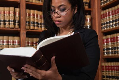 Woman reading in law library