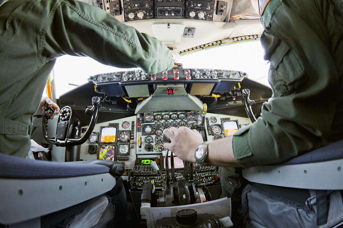 Two pilots working controls in a KC-135