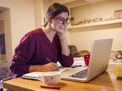 smiling woman using her computer