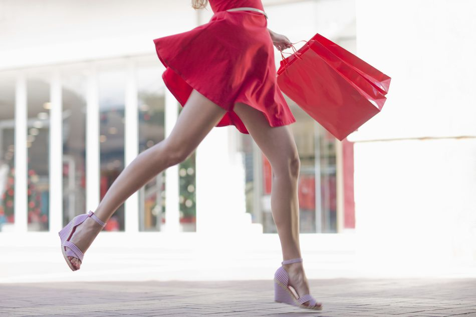 Woman in a red dress with a shopping bag