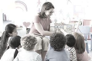 A teacher reading to children