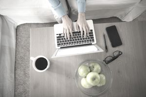 Top view of woman working on a lap top