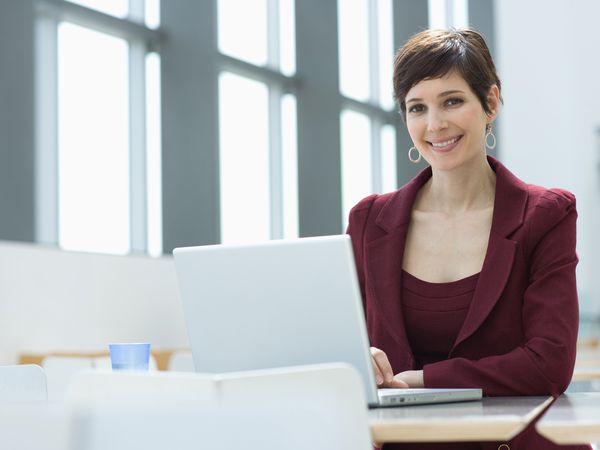 New employee smiling after reading business-wide email introducing her.