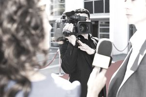 TV cameraman shooting an interview without a tripod