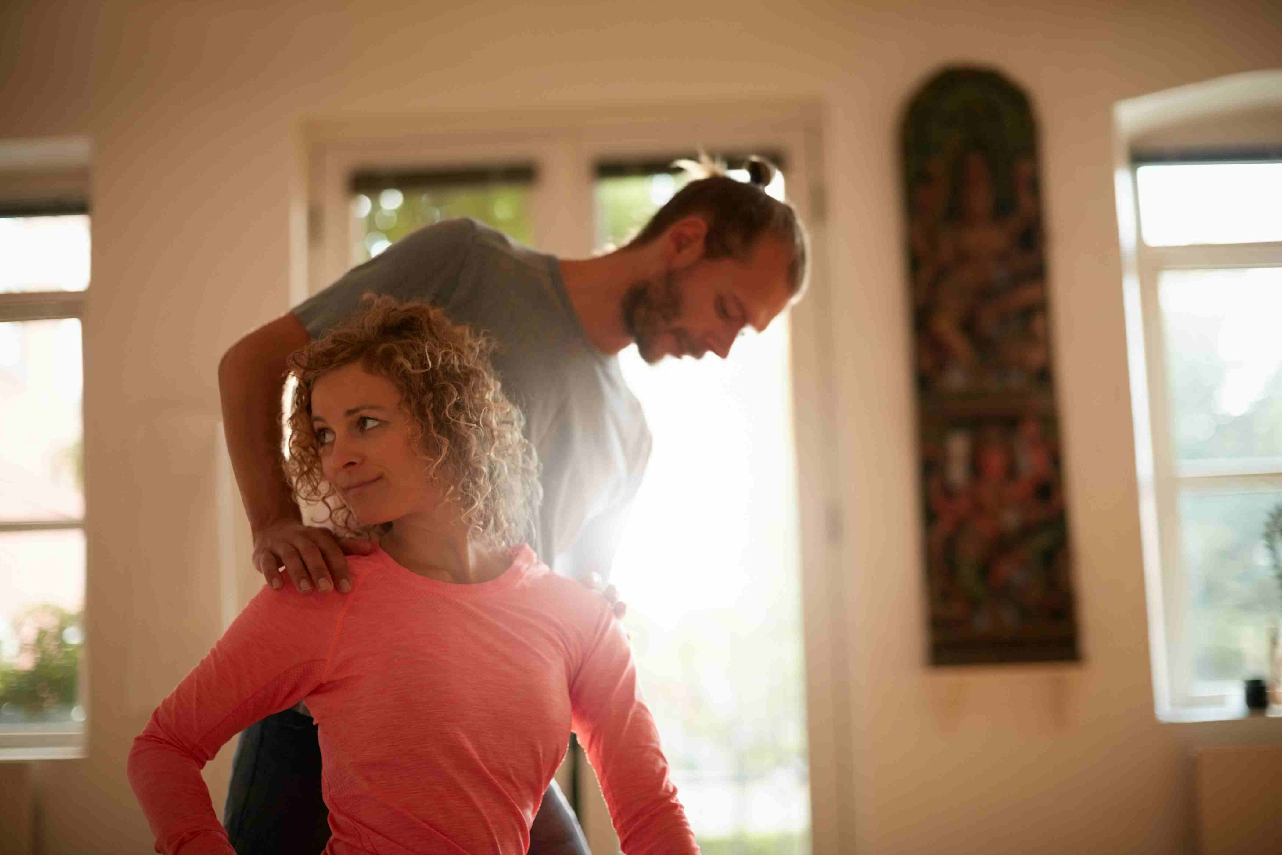 yoga therapist helping a client
