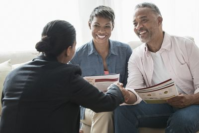African American couple talking to businesswoman