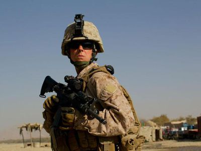 MUSA QALA, AFGHANISTAN - NOVEMBER19: (SPAIN OUT, FRANCE OUT, AFP OUT) Sargent Sheena Adams, 25, US Marine with the FET (Female Engagement Team) 1st Battalion 8th Marines, Regimental Combat team II stands guard while on patrol on November 19, 2010 in Musa Qala, Afghanistan.