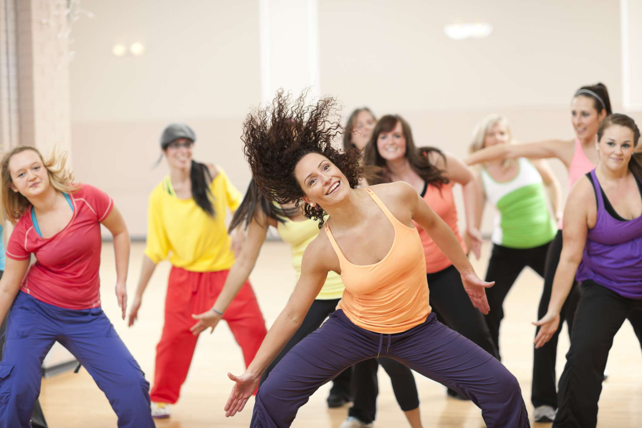 Female fitness instructor leading a dance class