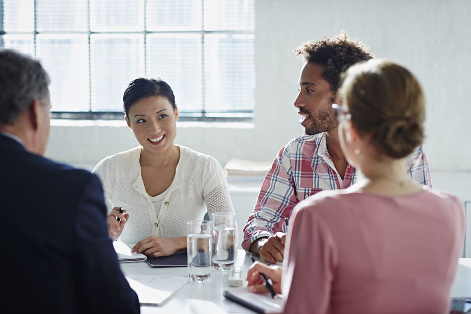 coworkers meeting teamwork interview questions