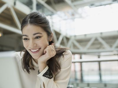 woman smiling while reading email