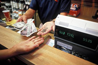 Retail Clerk Gives Change to Customer