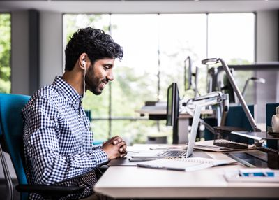 Man on video conference in modern office